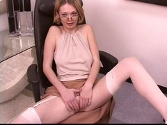 Mature leggy blonde spreads her pretty pussy at work