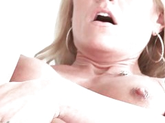Slutty blonde MILF fingers her dripping wet cunt