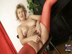 Blonde MILF Jaromira fingers her pussy and uses a dildo on it