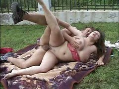 Busty BBW brunette is in the backyard and blows and gets drilled