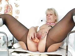 Blond milf in latex uniform extreme dildo insertio