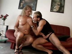 Chubby blonde granny nibbles on his young dick and gets banged