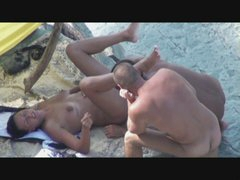 hot mom enjoys threesome on the beach
