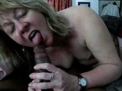 Blonde mature is giving this black cock head and takes his cum