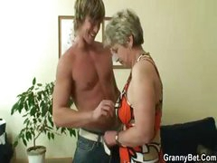 Blonde granny gets young stud's cock in her mouth and pussy