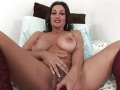 Provocative brunette momma sticks vibrator up her twat