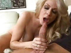 Heavy chested blonde milf takes huge weiner in her mouth
