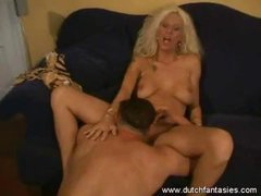 Busty blonde MILF with cool tattoos likes fucking in different positions