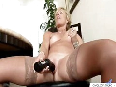 Racy MILF slut with an off-base quim gets off from a dildo