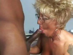 Chubby, wrinkled blonde granny with tattoos gets a piece of big black boner