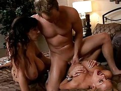 Two horny tanned milfs with huge puppies get nailed by one dick