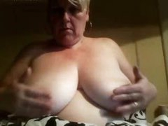 Karen is a large amateur mature blonde that likes playing with her fat pussy