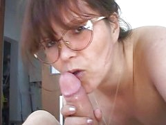 Dirty bitch in glasses sucking tasty cock