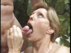 Park bench screwing for a short-haired mature blonde and a hunk
