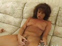 Mature babe toying hairy pussy