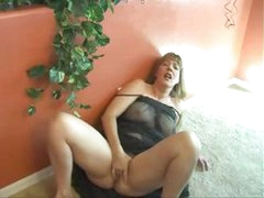 Busty mature brunette mom Afton wears a see through black nightie and masturbates