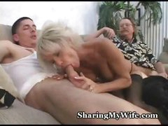 Mature busty blonde gets it with one guy while the other watches