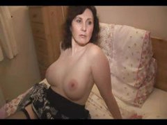 Mature amateur brunette strips in the kitchen and poses on the bed for hubby