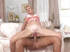 Mature blonde, Helena, can ride a young cock like a cowgirl