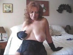 Busty mature goes solo and wears her masturbation gloves on cam