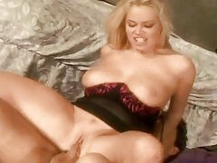 Bootylicious blonde milf with big hooters rides on stiff pecker