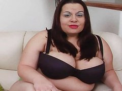 Sexy huge dark haired momma with extra large bosom masturbates