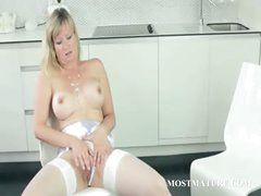 MILF in stockings teasing twat on a chair