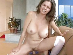 Busty milf rides a young cock