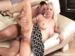 Sexy blonde cougar, Veronica Vaughn, gets fucked by a guy on the couch