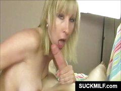 Blonde mom with nice tits is sucking on his big cock in POV