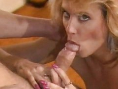Pornstar legend Ginger Lynn eagerly hooks her mouth on her lovers warm cock