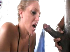 Sexy blonde masked babe buries his big black boner down her throat