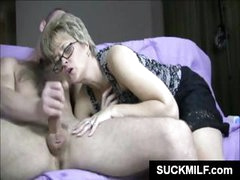 Mature blonde in glasses munches on a hard piece of young dick
