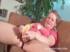 Mature babe masturbates with a banana