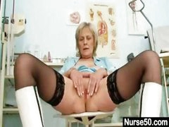 Blonde granny nurse gives herself her own gyno exam on her pussy