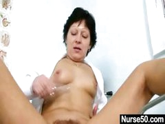 Mature brunette giving a self exam and using tool to stretch pussy