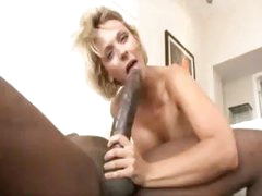 Blonde Brinna Beach takes on Mandingo's very large black cock
