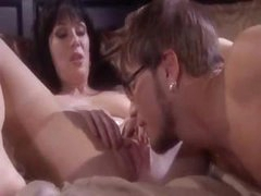 Brunette MILF gets dirty with a young stud and sucks and bangs him