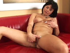 Linette strokes her mature pussy